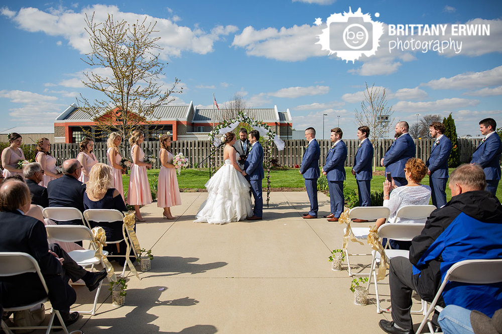 Columbus-Indiana-outdoor-elks-lodge-wedding-ceremony-disney-theme-couple-at-altar.jpg