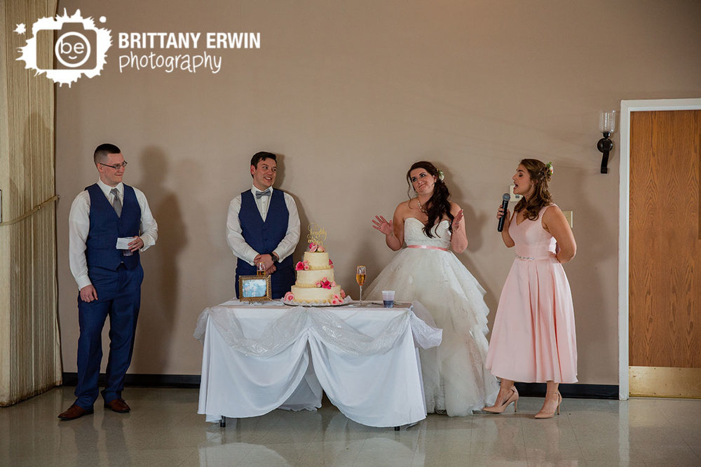 Columbus-Indiana-wedding-reception-photographer-cake-table-toast-maid-of-honor.jpg