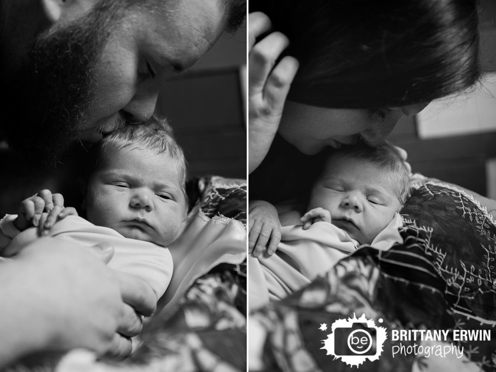 Indianapolis-in-home-newborn-portrait-photographer-mother-father-kiss-baby-girl.jpg
