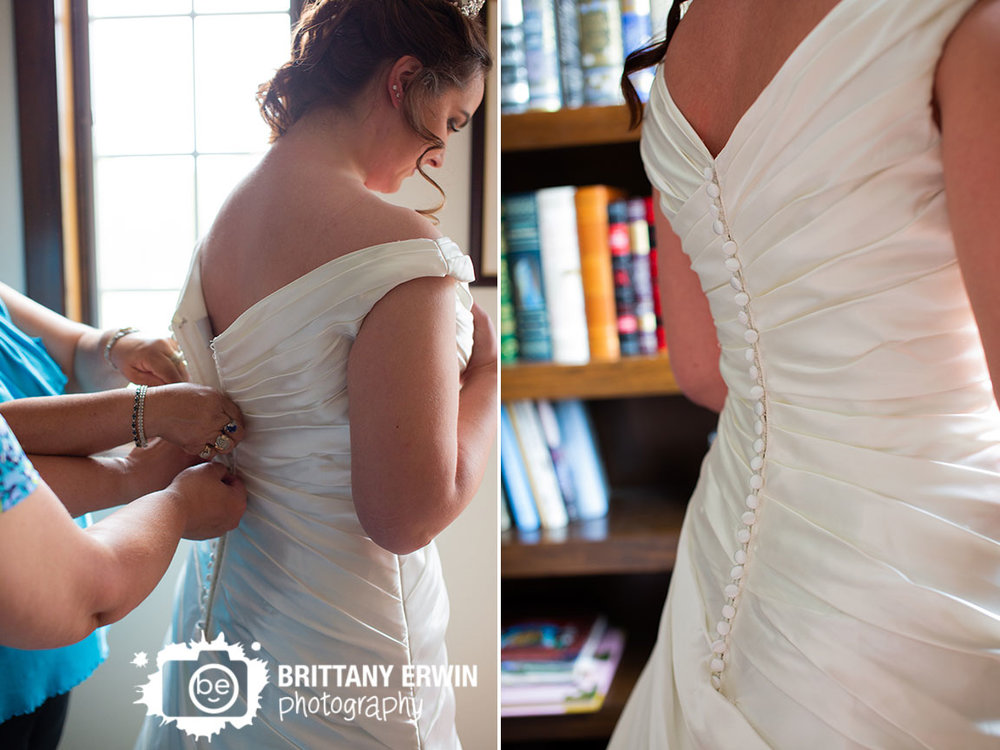 Clayshire-castle-button-back-dress-bride-in-window-of-library.jpg