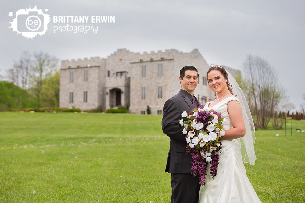 Clayshire-Castle-Indiana-wedding-photographer-couple-in-front-of-venue.jpg
