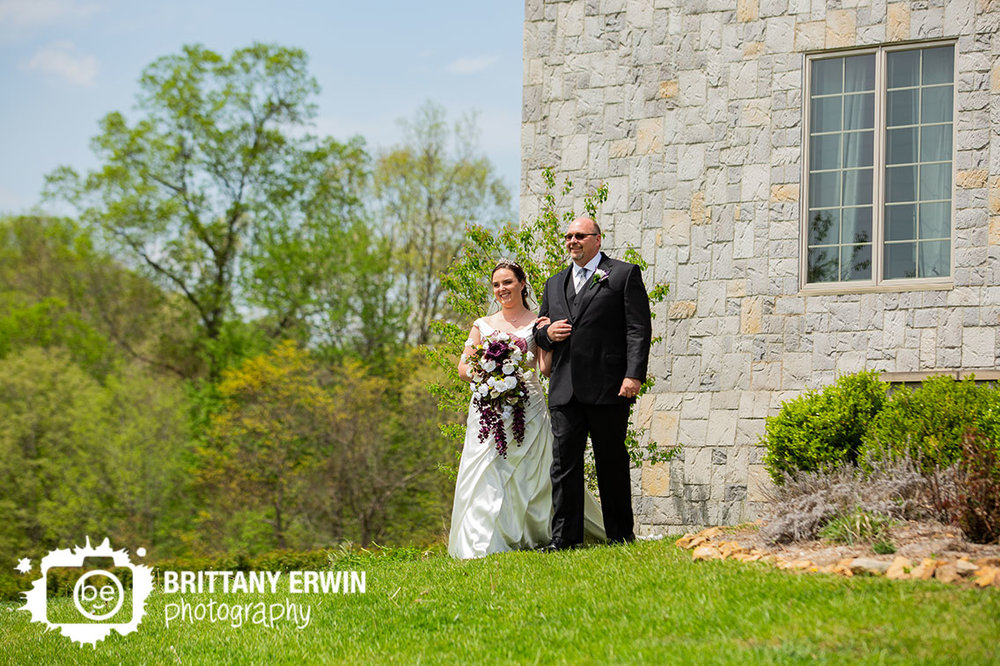 Clayshire-Castle-wedding-ceremony-photographer-bride-walking-from-building-with-father.jpg