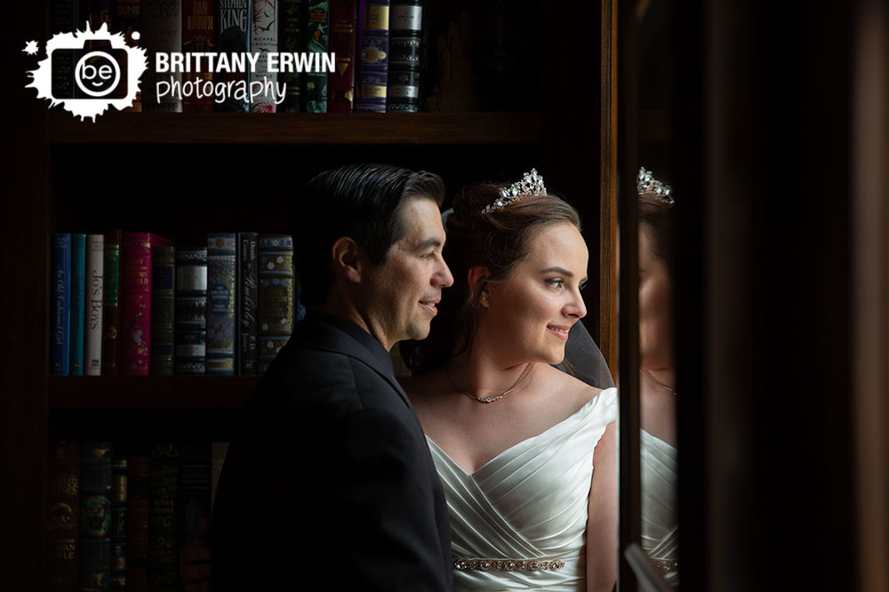 Clayshire-Castle-wedding-photographer-couple-library-looking-out-window.jpg