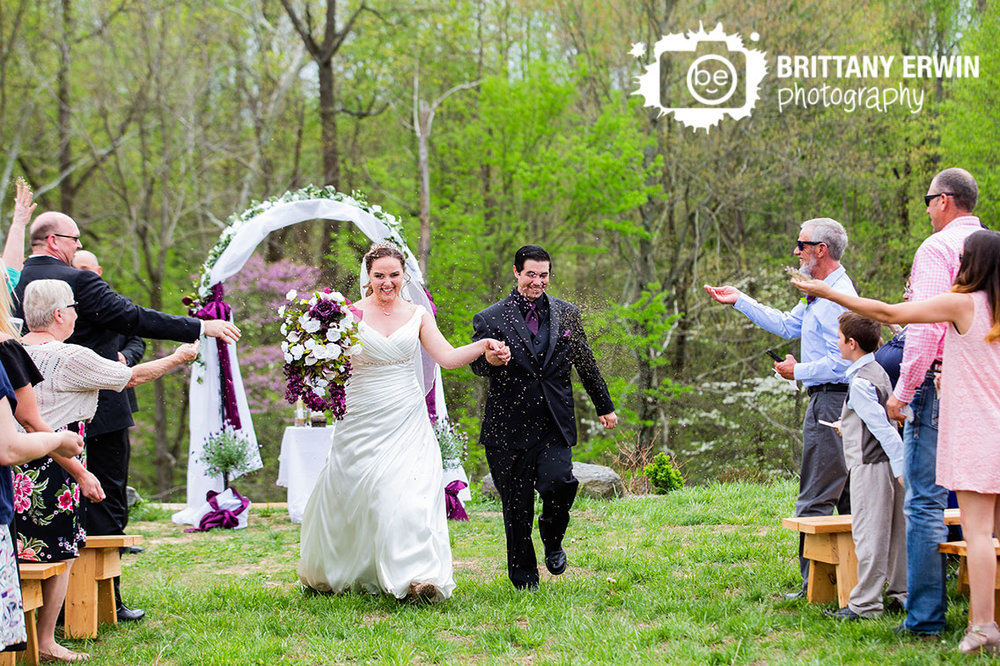 Outdoor-wedding-ceremony-photographer-couple-announced-down-aisle-throw-lavender-and-herbs-over-bride-and-groom.jpg