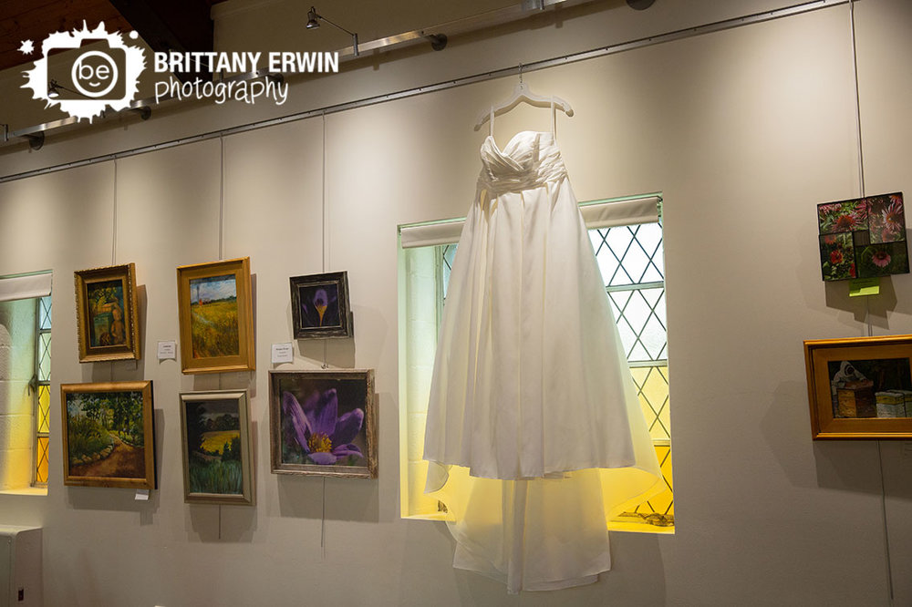 Art-Sanctuary-of-Indiana-wedding-photographer-bridal-gown-gallery-framed-window.jpg