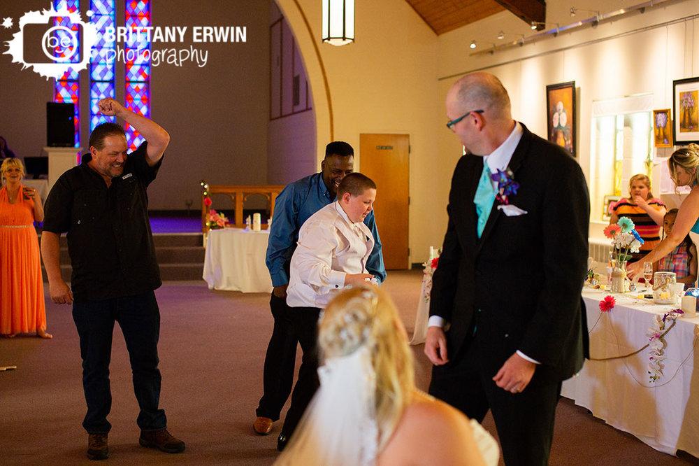 Wedding-reception-photographer-garter-toss-art-sanctuary.jpg