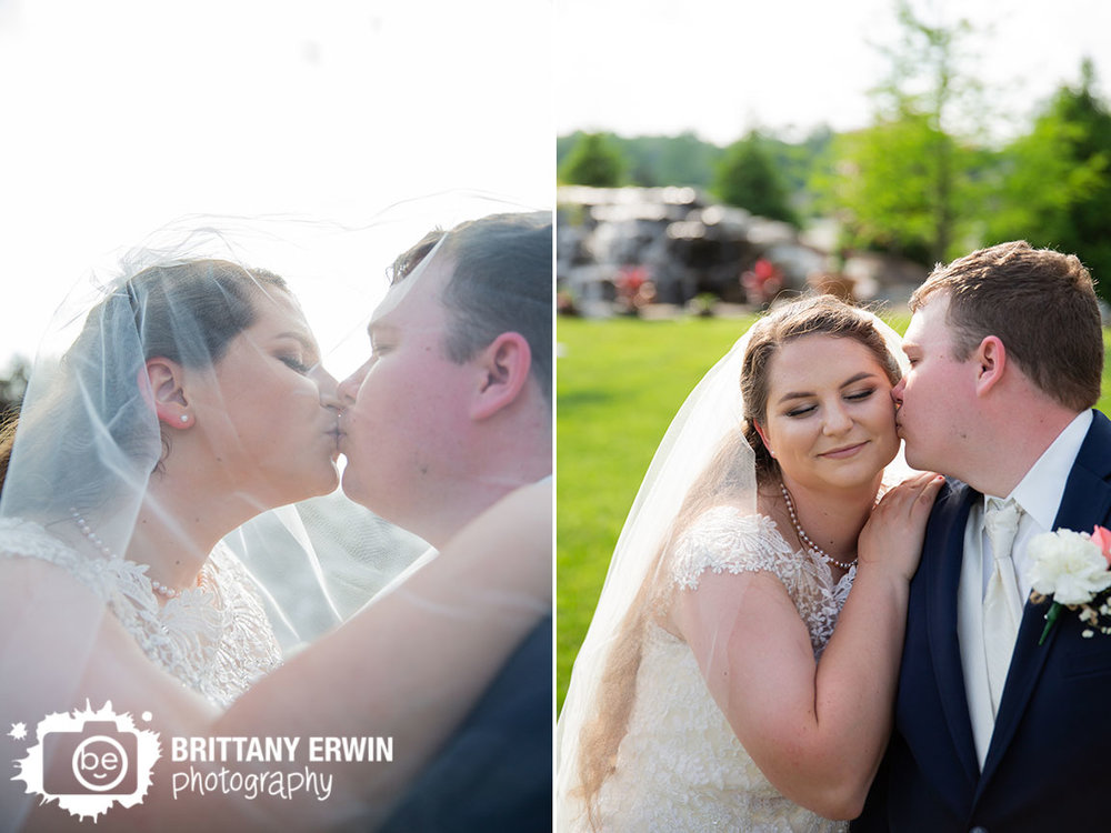 Outdoor-wedding-ceremony-portrait-couple-kiss-under-viel.jpg