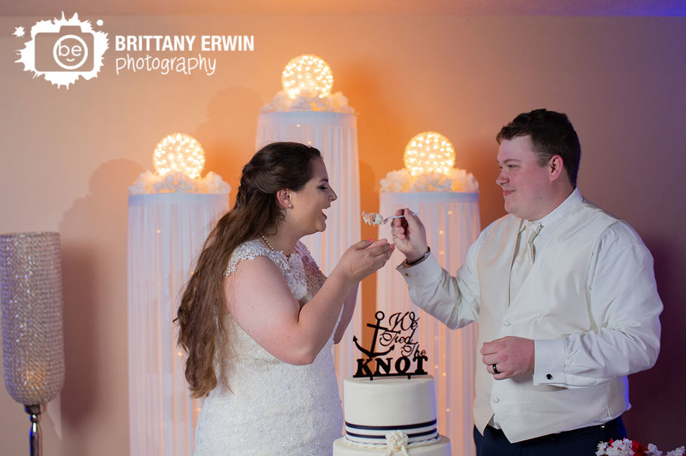 Jones-Crossing-Banquet-and-Event-Center-cake-cutting-feed-to-bride.jpg