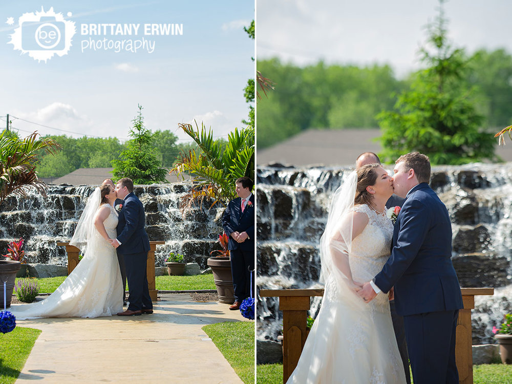 Jones-Crossing-wedding-ceremony-site-with-waterfall-backdrop-first-kiss.jpg