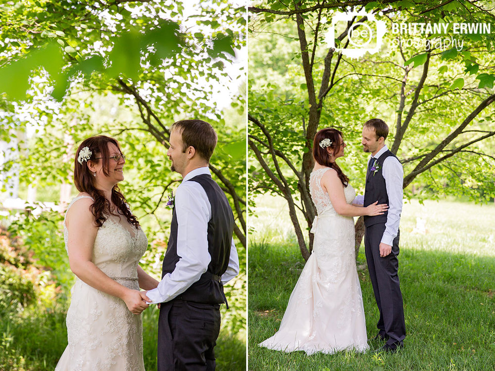 First-look-under-shade-tree-couple-reaction-lace-wedding-dress.jpg