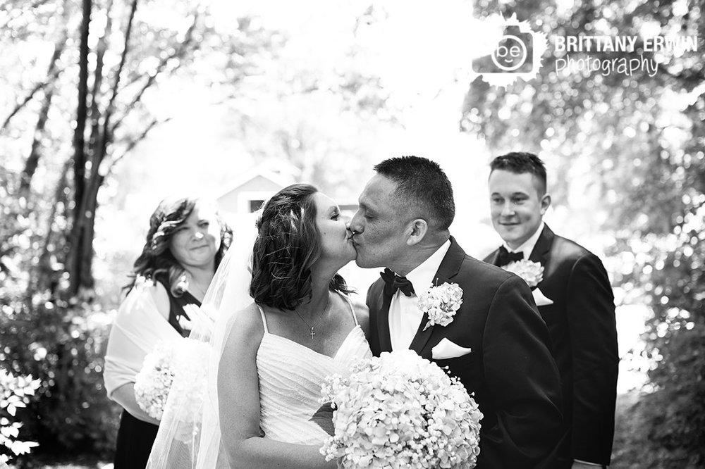 Bridal-party-photo-bride-groom-kiss-winery-wedding.jpg