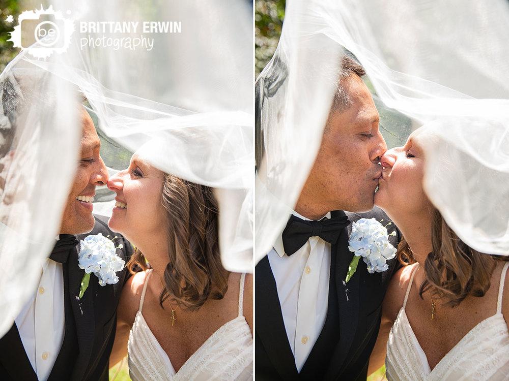 Couple-under-viel-bride-groom-kiss-terre-haute-watertower-estates.jpg
