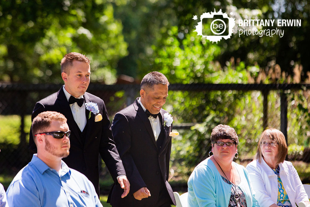 groom-walk-down-aisle-with-best-man-ceremony-photographer.jpg