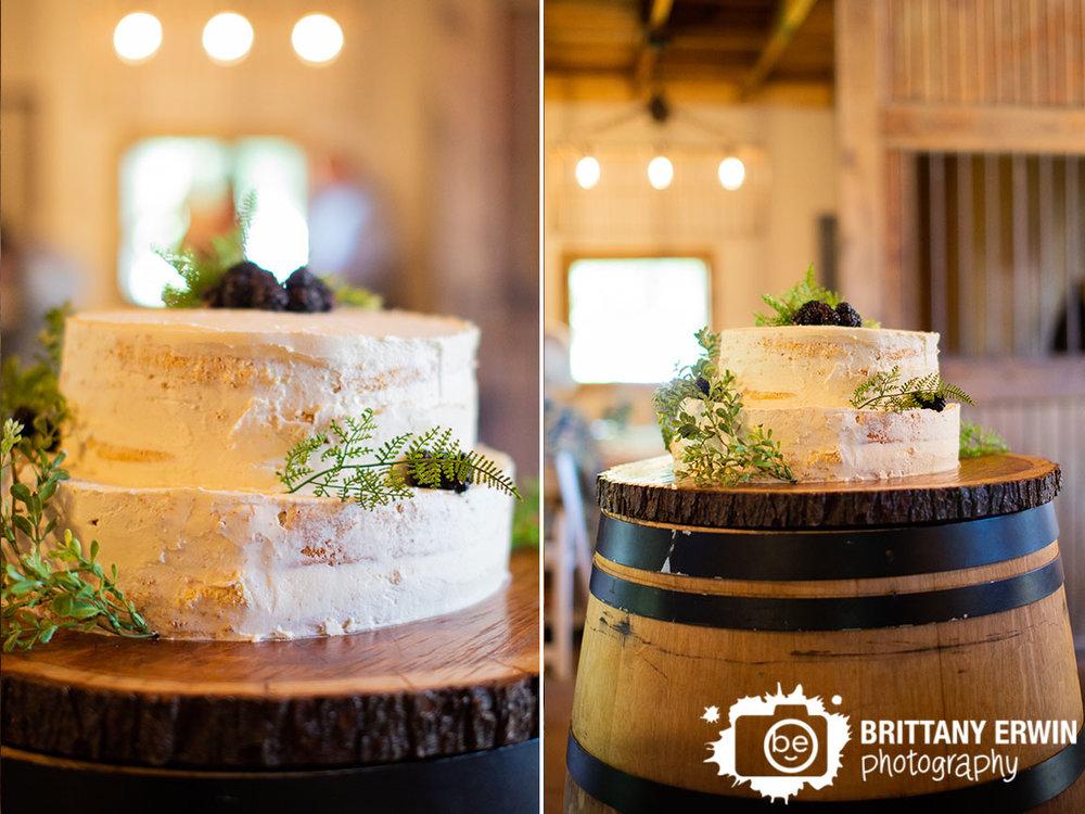 Naked-Cake-wedding-reception-herbs-and-berries-on-wine-barrel.jpg