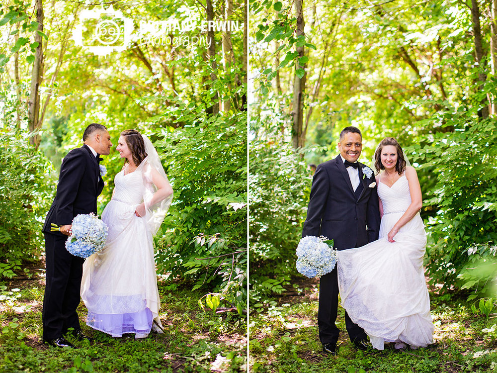 Wedding-photographer-couple-outside-watertower-estates-forest-path.jpg