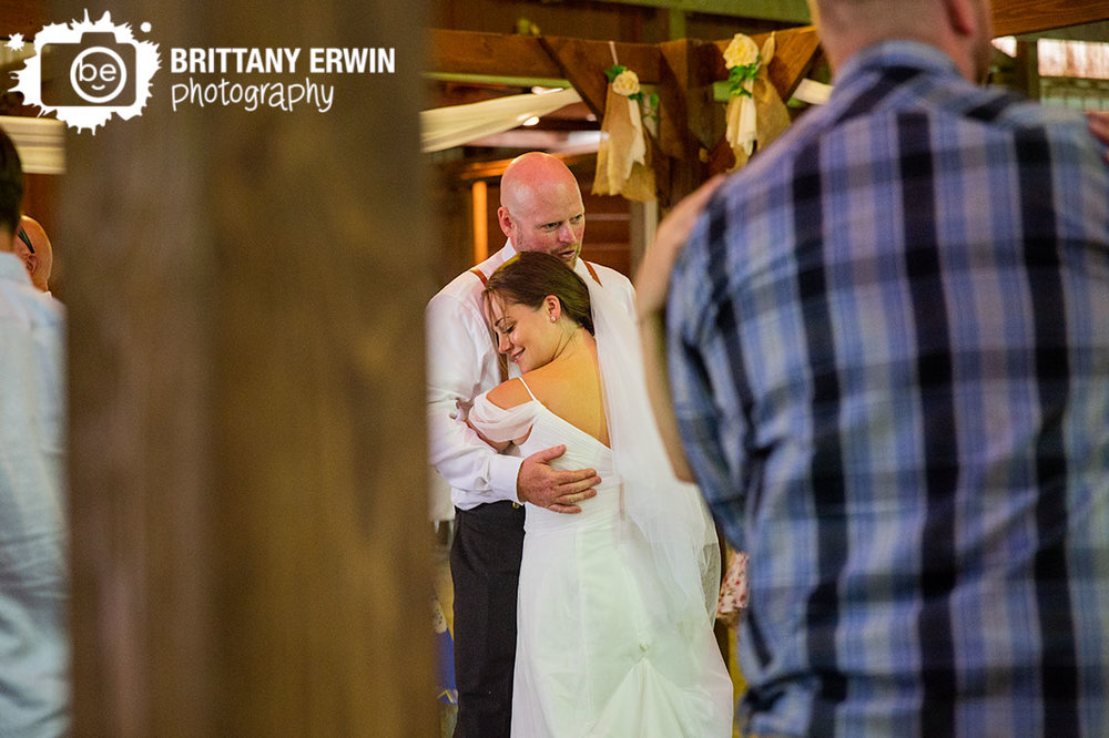 Bride-and-groom-first-dance-with-group-barn-wedding-photographer.jpg