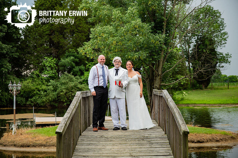 Colonel-Sanders-wedding-photographer-couple-bride-groom-on-bridge.jpg