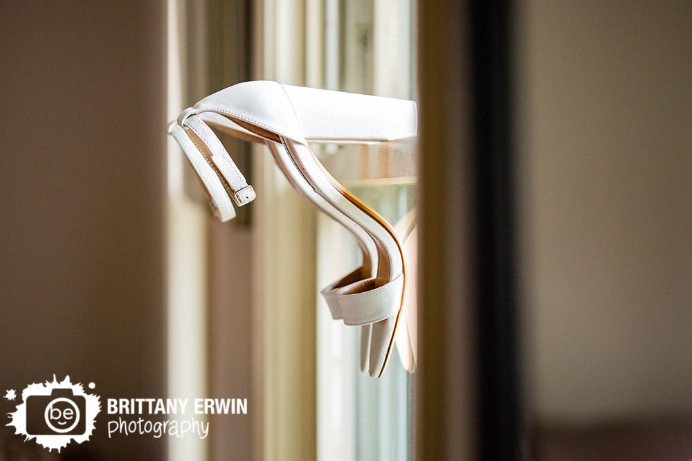 Indianapolis-wedding-photographer-shoes-in-window-hanging-on-sill.jpg