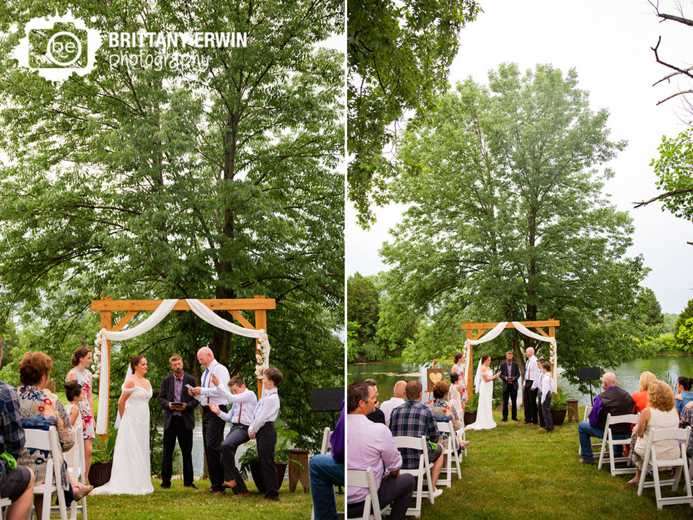 Outdoor-wedding-ceremony-wooden-arbor-couple-reading-vows.jpg