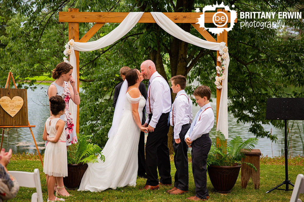 Wedding-ceremony-outside-couple-first-kiss-hustband-wife.jpg