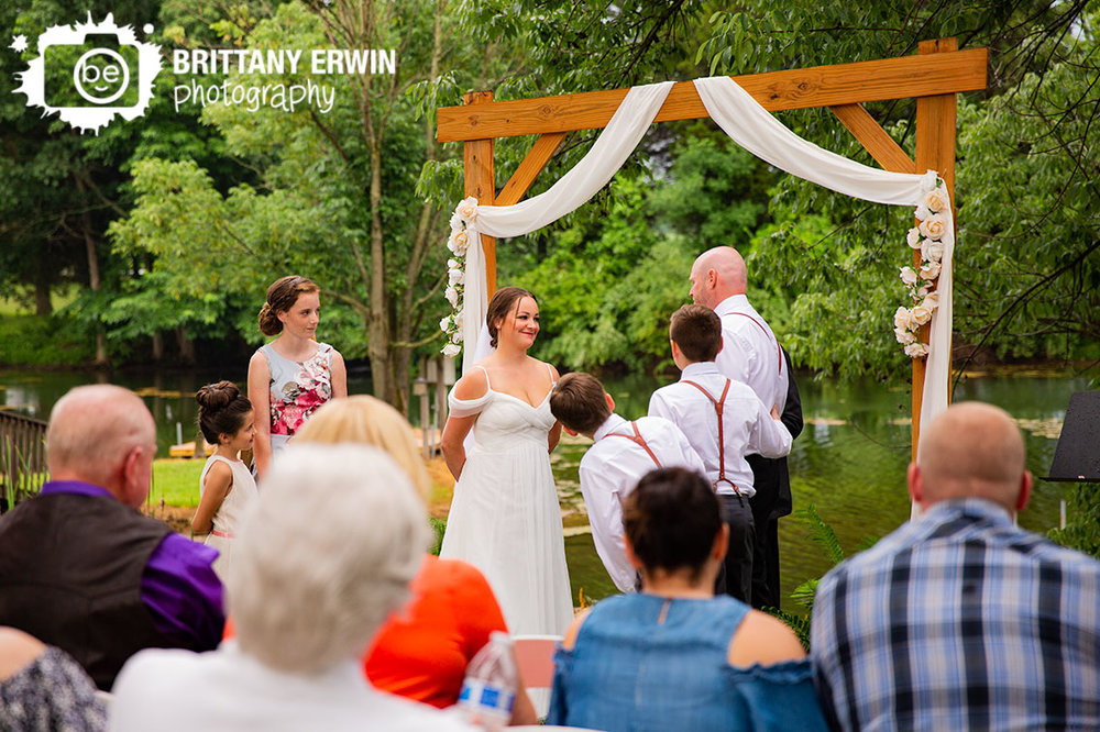 Wedding-photographer-outdoor-ceremony-bride-reaction-at-altar.jpg