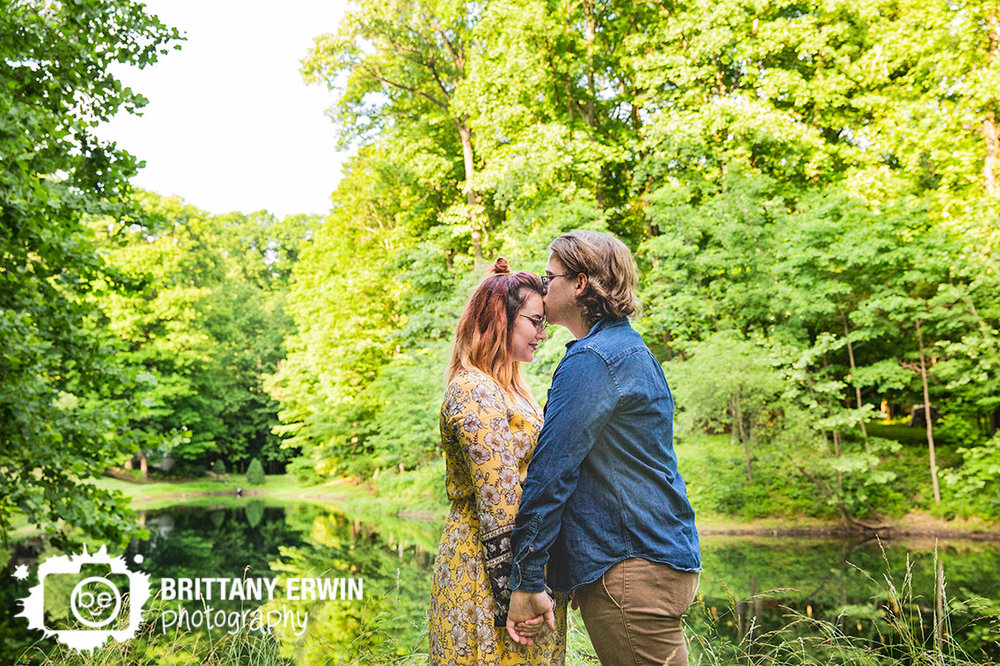 Outdoor-pond-portrait-session-couple-forehead-kiss.jpg