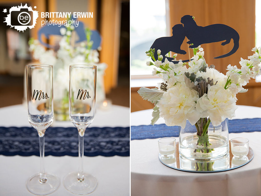 Indianapolis-zoo-wedding-photographer-centerpiece-otter-mr-mrs-toasting-flutes.jpg