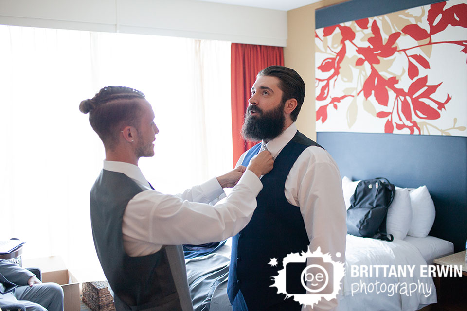 Indianapolis-wedding-photographer-groomsman-adjust-groom-tie.jpg