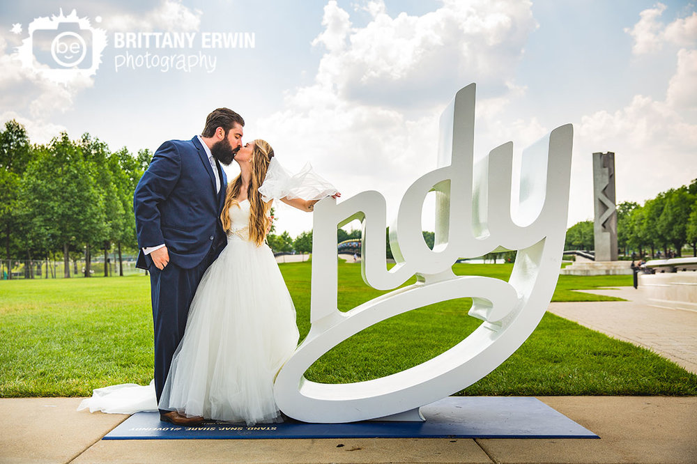 Indy-sign-Indianapolis-skyline-clouds-summer-wedding-portrait.jpg