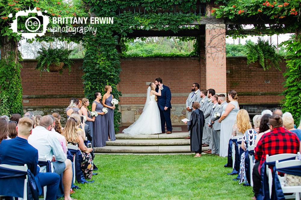 First-kiss-indianapolis-zoo-wedding-garden-ceremony.jpg