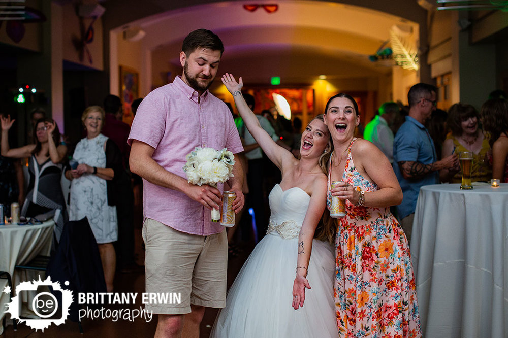 Wedding-photographer-reception-bouquet-toss.jpg