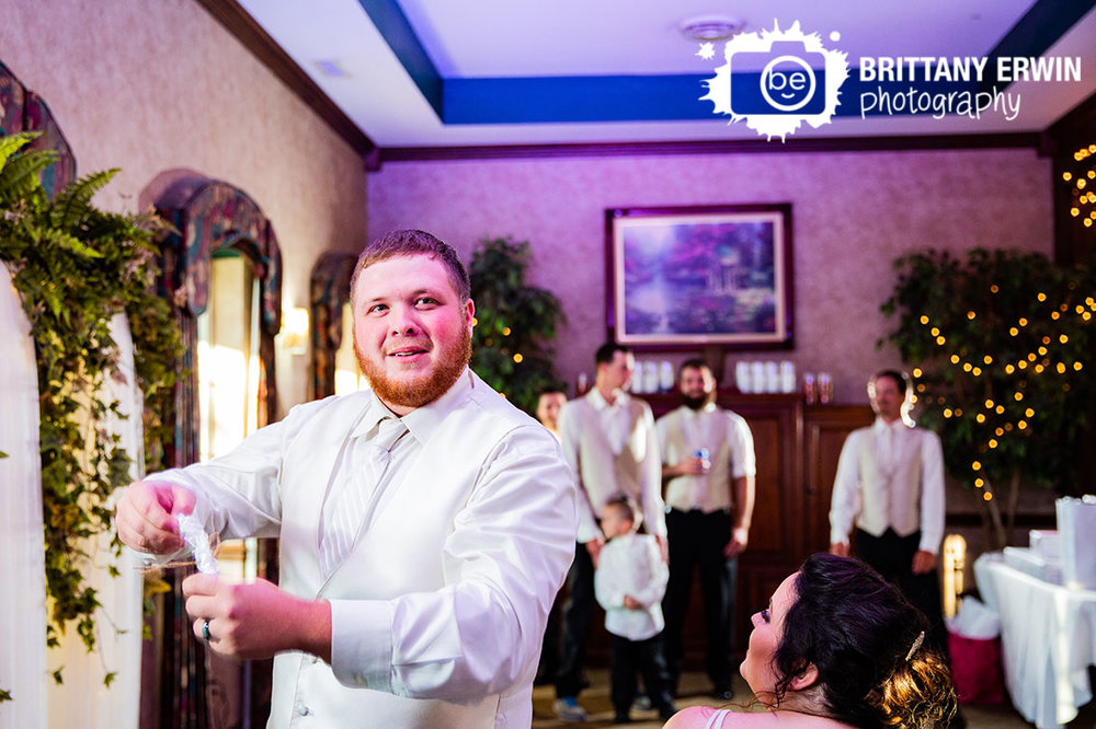 Heartland-Crossing-wedding-reception-garter-toss-groom.jpg