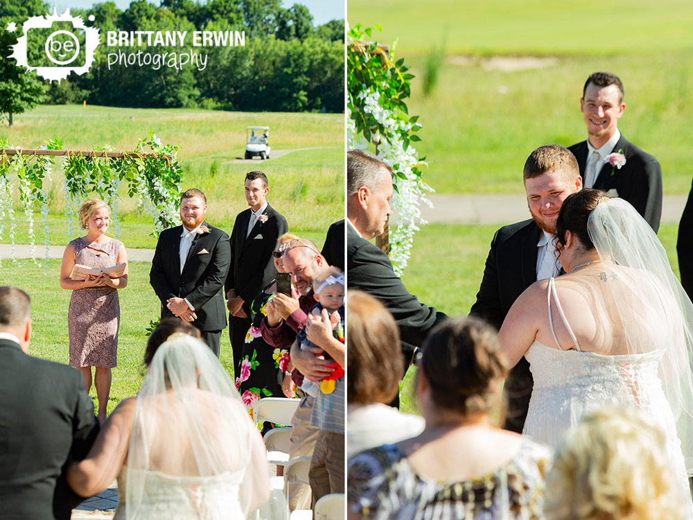 Heartland-Crossing-wedding-ceremony-photographer-arbor-flower-hanging.jpg
