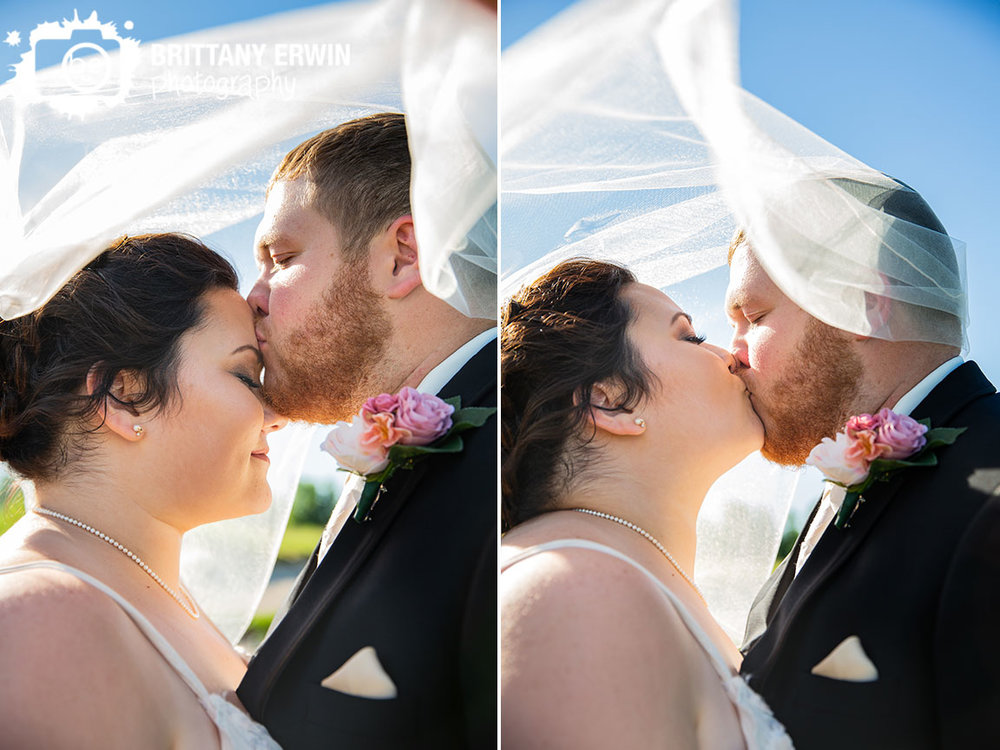 couple-forehead-kiss-under-viel-summer-wedding.jpg