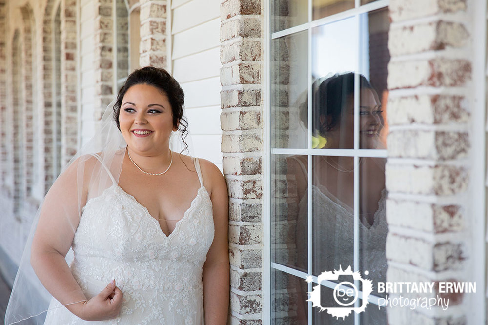 bride-portrait-outside-heartland-crossing-golf-links-porch-brick-wall.jpg