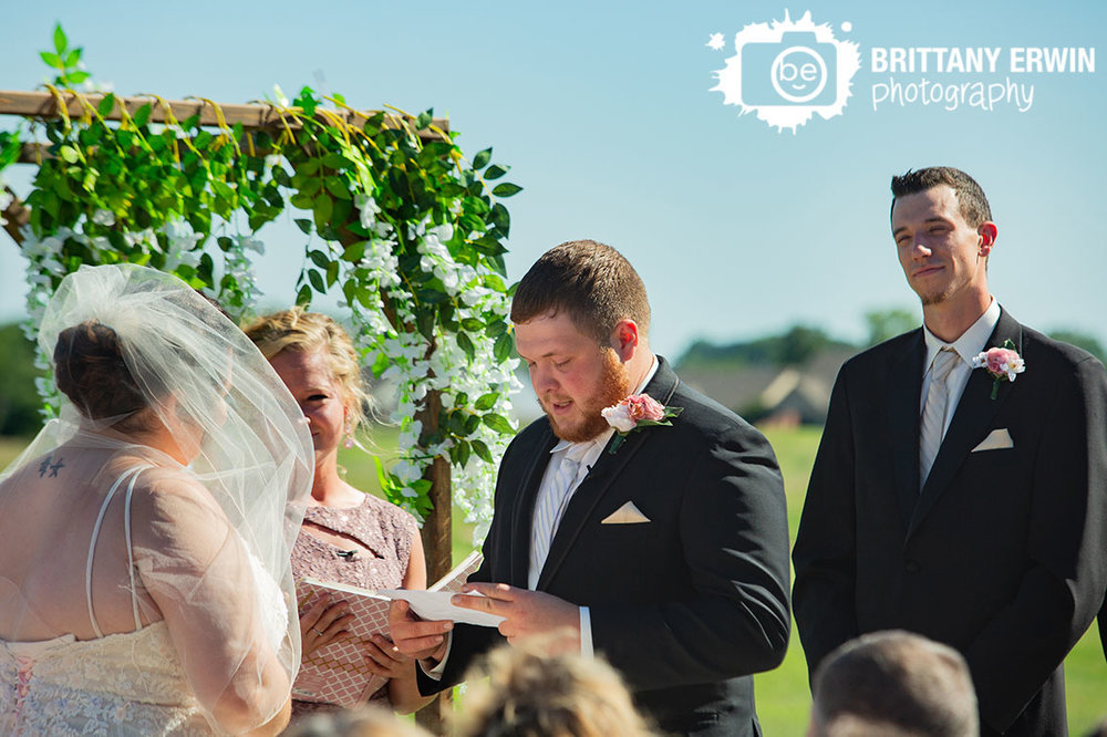 Wedding-ceremony-photographer-groom-reading-vows.jpg