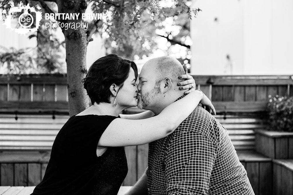 Engagement-portrait-photographer-couple-kiss-outdoor-summer-session.jpg