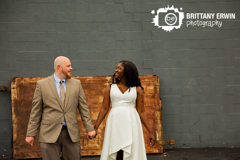 rustic-rusty-door-funky-bridal-portraits-couple-walking-outside-speakeasy.jpg