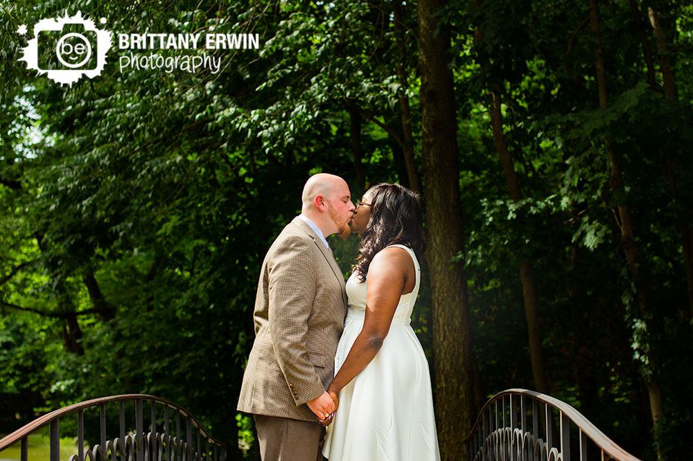 holcomb-gardens-wedding-day-portrait-on-bridge-wooded-path.jpg
