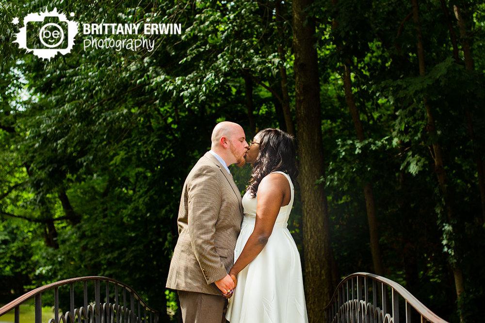 holcomb-gardens-wedding-day-portrait-on-bridge-wooded-path.jpg