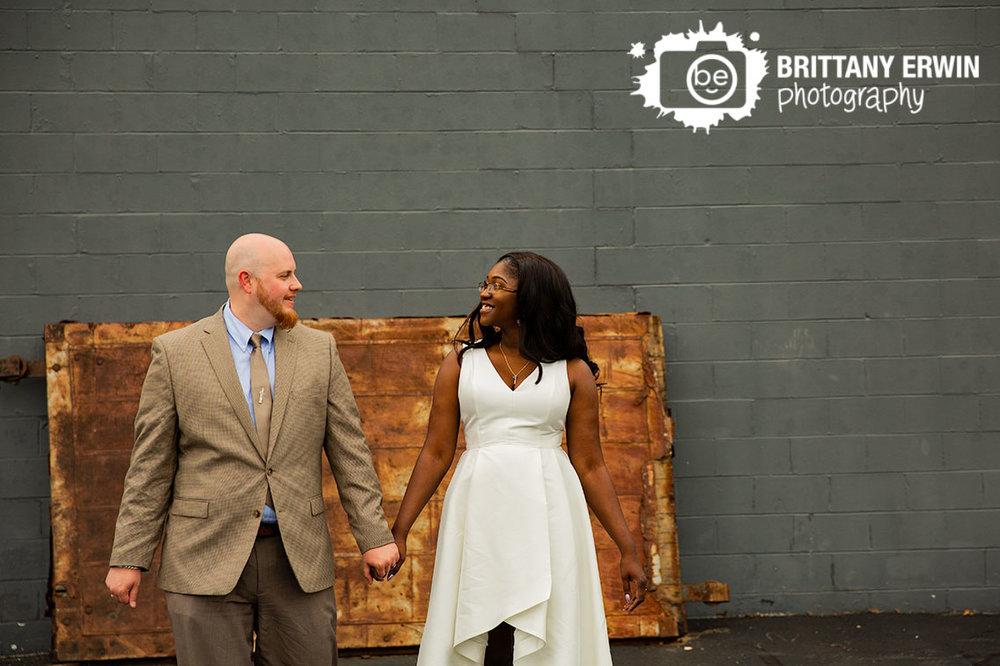 rustic-rusty-door-funky-bridal-portraits-couple-walking-outside-speakeasy.jpg