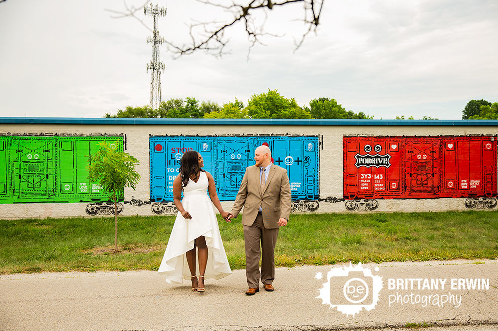 the-speak-easy-wedding-photographer-reception-portraits-couple-train-mural.jpg