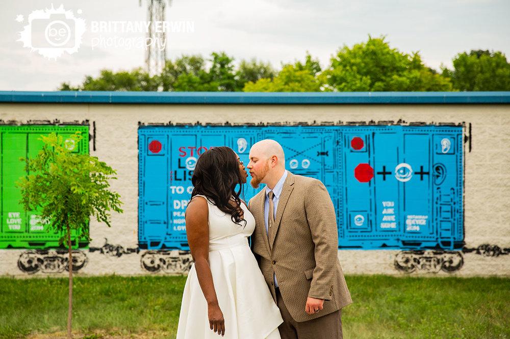 monon-trail-train-car-mural-building-couple-kiss-wedding-day.jpg