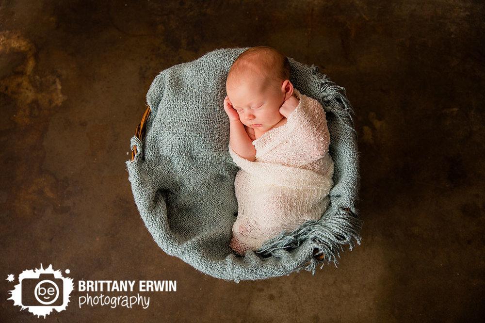 newborn-studio-photographer-baby-boy-asleep-wrapped-in-basket.jpg