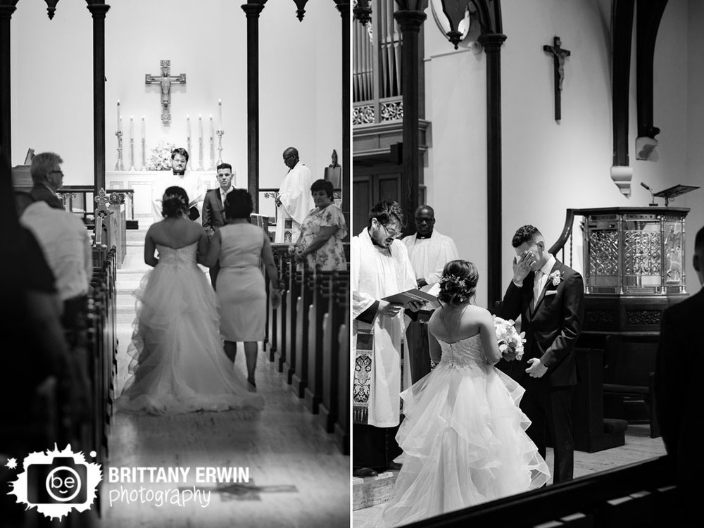 Indianapolis-wedding-photographer-groom-reaction-bride-walking-own-aisle-catholic-ceremony.jpg