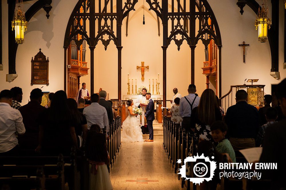 Indianapolis-wedding-photographer-couple-at-altar-catholic-church.jpg