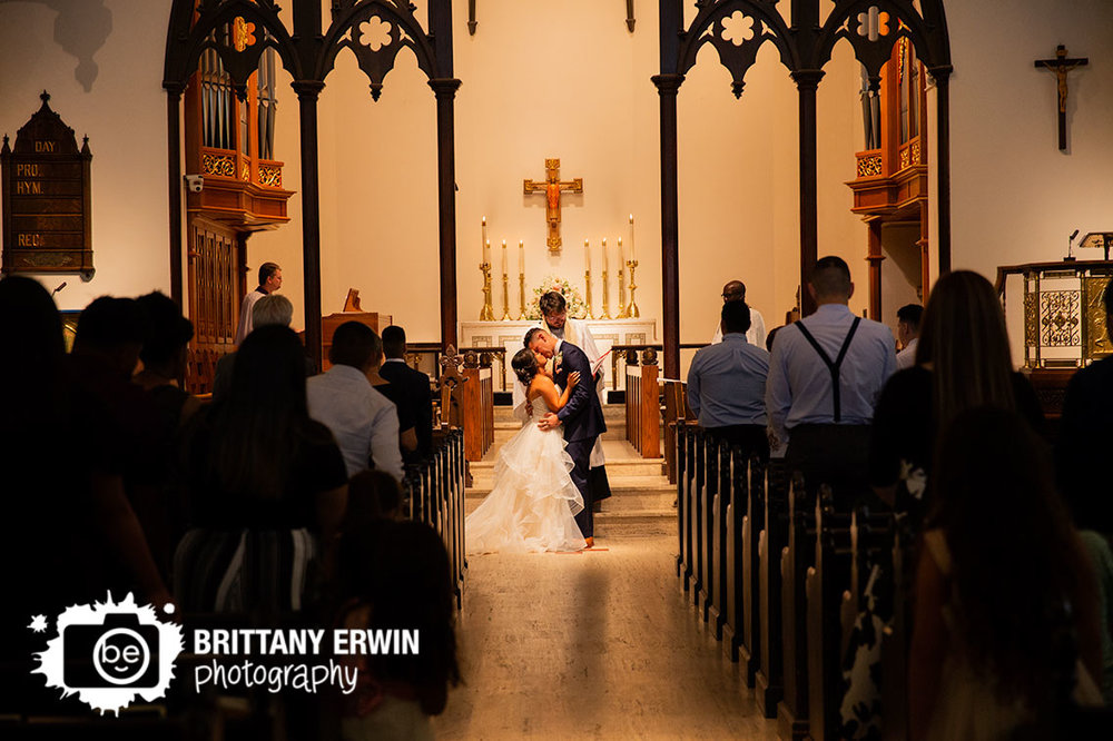 Downtown-Indianapolis-wedding-photographer-first-kiss-catholic-ceremony.jpg