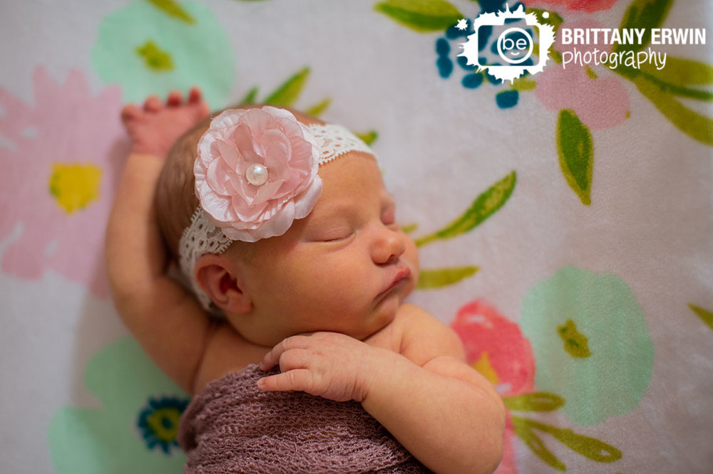 Indianapolis-newborn-lifestyle-portrait-photographer-baby-girl-asleep-on-flower-sheet-crib.jpg