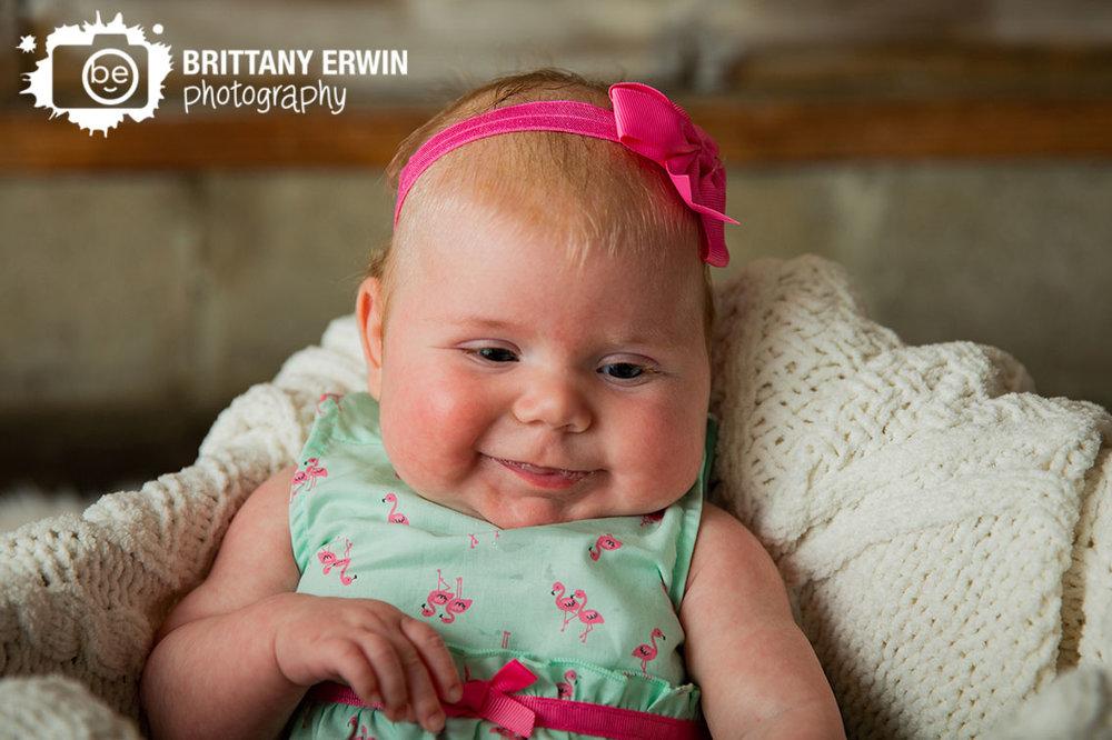 Smily-girl-blowing-bubbles-studio-portrait-photographer-pink-bow.jpg