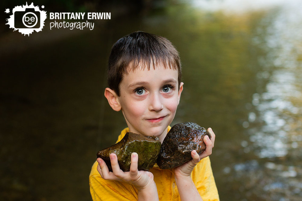 Indianapolis-portrait-photographer-boy-with-rocks-in-creek.jpg